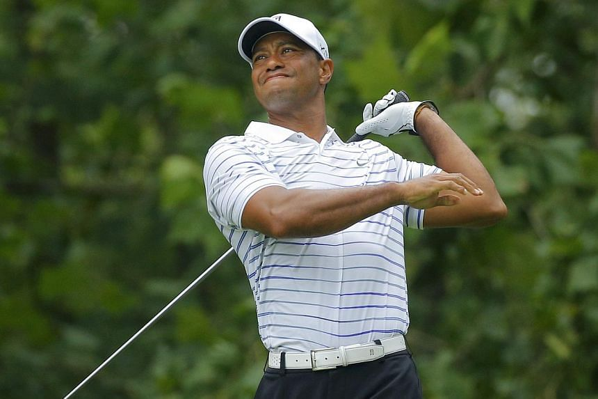 Tiger Woods of the US grimaces after hitting his tee shot on the seventh hole during the second round of the 2014 PGA Championship at Valhalla Golf Club in Louisville, Kentucky, on August 8, 2014. Woods has played a limited schedule this year followi