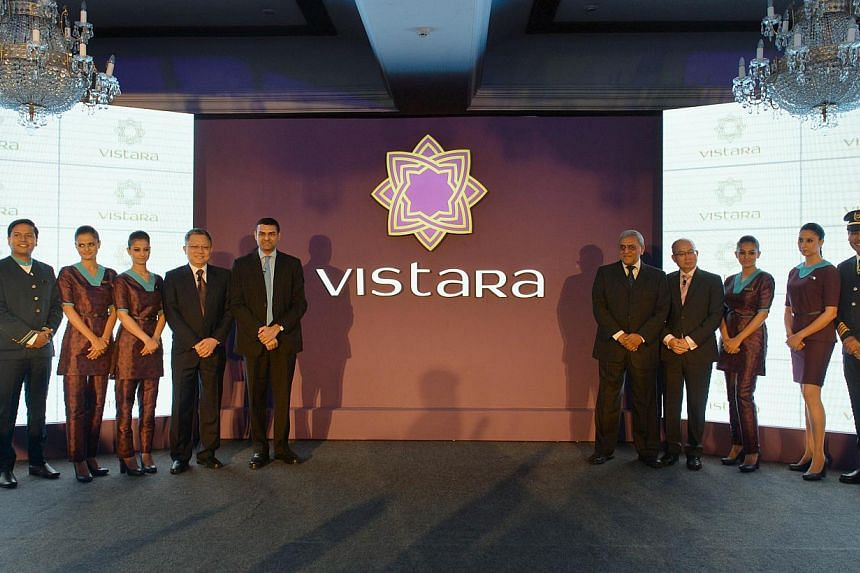 Staff members of TATA SIA Airlines Limited (TSAL) pose during the launch of the new brand name 'Vistara' - a Sanskrit word denoting limitless expanse - for the new airline in New Delhi on August 11, 2014. --PHOTO: AFP