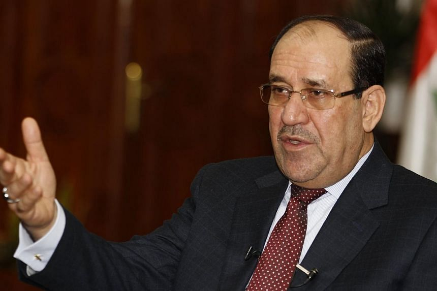 Iraq's Prime Minister Nuri al-Maliki speaks during an interview with Reuters in Baghdad on Jan 12, 2014.Iraq's caretaker prime minister Nuri al-Maliki said Wednesday, Aug 13, 2014, that it will take a federal court ruling for him to leave power
