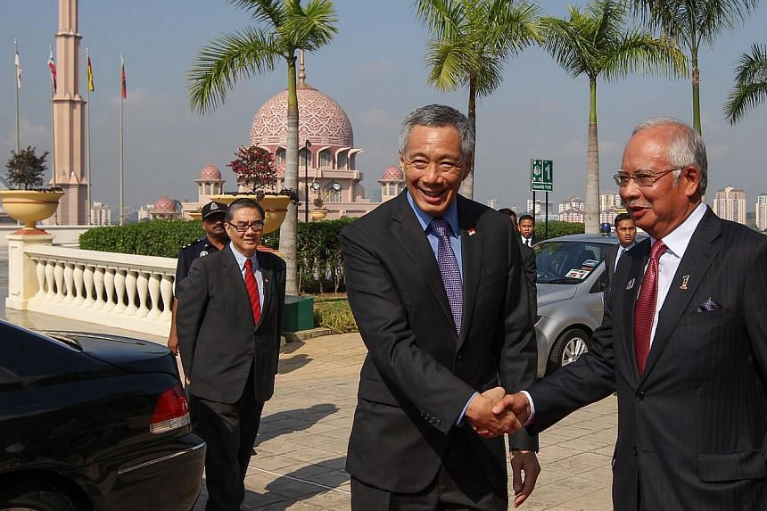 Prime Minister Lee Hsien Loong with Malaysia's Prime Minister Najib Razak at the Malaysia-Singapore Leaders' Retreat in Putrajaya in April. Mr Lee and Datuk Seri Najib enjoy a warm relationship and their resolution of a long-standing dispute over Mal