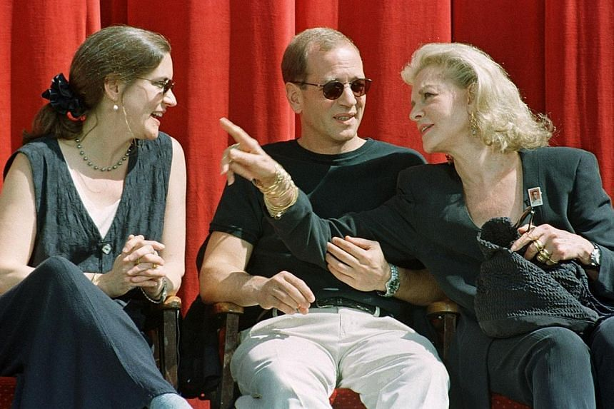 Actress Lauren Bacall (right), widow of actor Humphrey Bogart, talks with her children Leslie and Stephen at ceremonies honouring Humphrey Bogart with an honorary postage stamp at Mann's Chinese Theatre in Hollywood, California in this file picture t