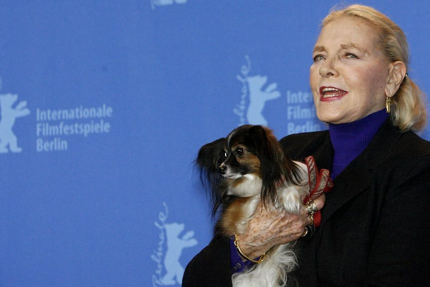 US actress Lauren Bacall poses with her dog Sophie during a photocall to present her film The Walker at the 57th Berlinale International Film Festival in Berlin in this file picture taken on February 13, 2007. -- PHOTO: REUTERS