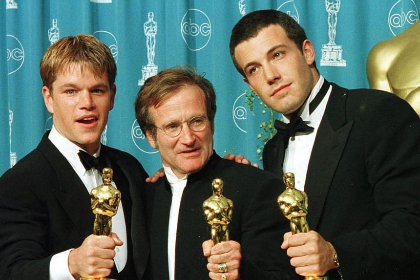 In this March 23, 1998 file photo, actors-writers Matt Damon (left) and Ben Affleck (right) pose with actor Robin Williams with the Oscars they won for Good Will Hunting at the 70th Annual Academy Awards in Los Angeles. Affleck said on Tuesday he was