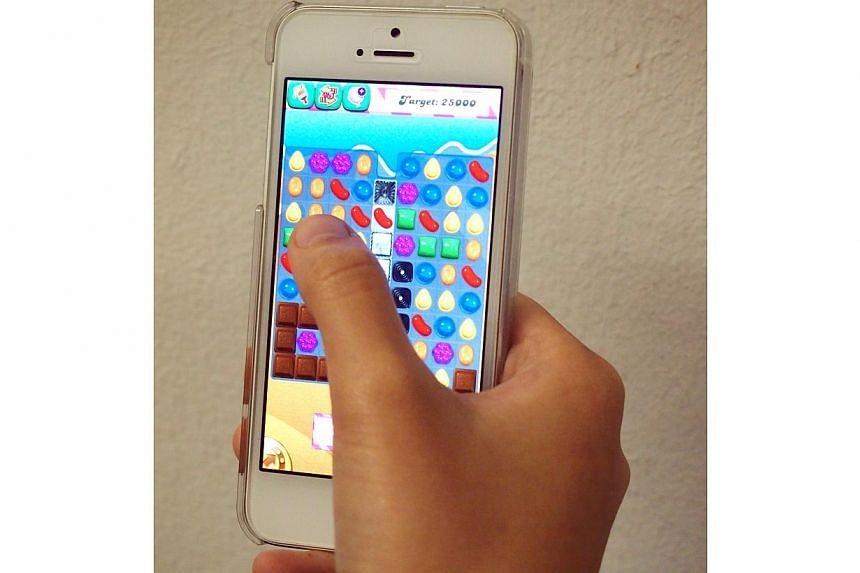 The Candy Crush game shown on a mobile phone.-- PHOTO: THE NEW PAPER FILE