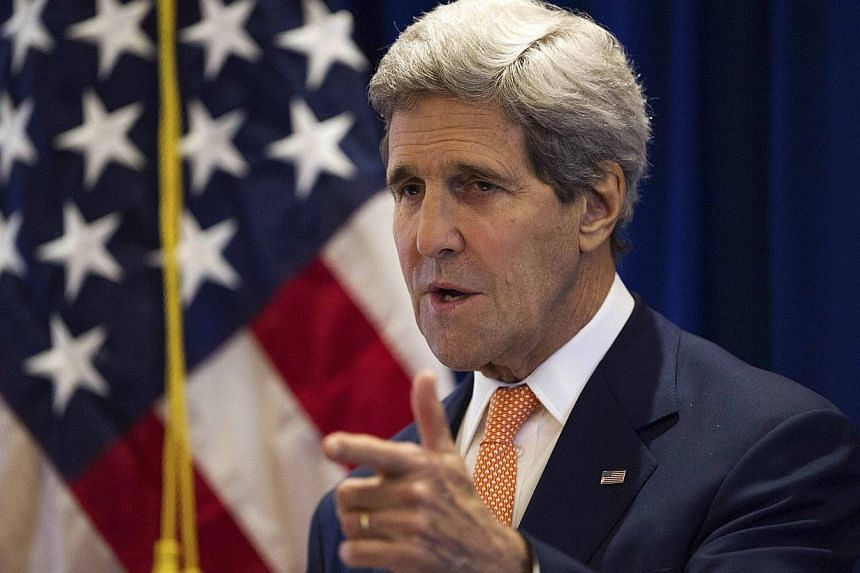 US Secretary of State John Kerry speaking during a news conference at the Lake Garden Hotel, outside the venue of the 47th Asean Foreign Ministers' Meeting, in Naypyidaw on August 10, 2014. The hotelis owned by sanctioned tycoon Zaw Zaw's Max M