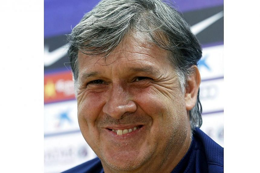 Former Barcelona's coach Gerardo Martino smiles during a news conference in Barcelona in this May 16, 2014 file photo.Martino was named coach of Argentina on Tuesday replacing Alejandro Sabella who stood down after they lost 1-0 to Germany in J