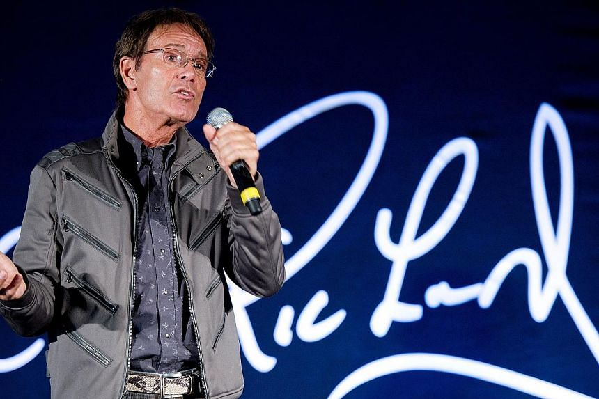 British musician Sir Cliff Richard attends a press conference in London to promote his yet-to-be recorded album of soul classics on March 7, 2011. British police searched a property belonging to Richard on Thursday, Aug 14, 2014, as part of an invest