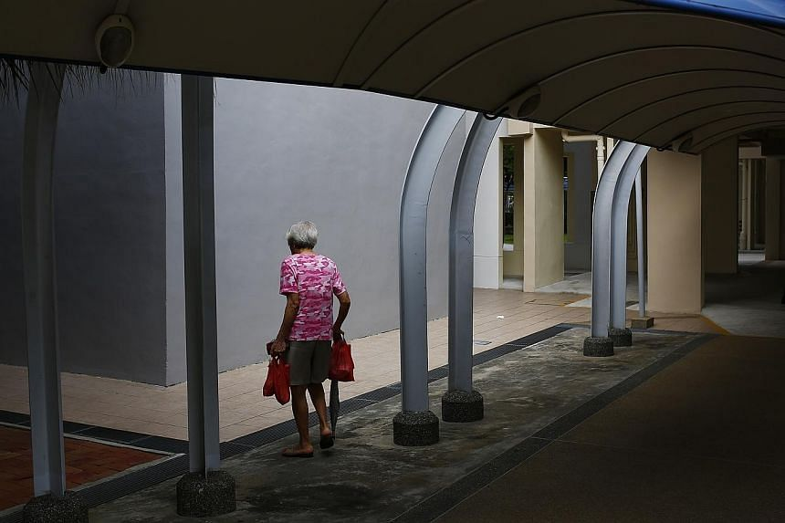 An elderly woman walks under a sheltered walkway in Marine Terrace on Feb 8, 2013. People are getting more tech-savvy so studio apartments for the elderly should in the future have video conferencing technology. -- PHOTO: ST FILE