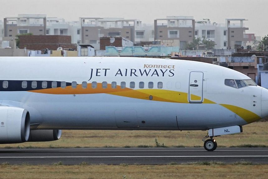 A Jet Airways passenger plane moves along the tarmac at the Sardar Vallabhbhai Patel international airport in the western Indian city of Ahmedabad on April 24, 2013.India's civil aviation regulator said it has ordered Jet Airways to suspend two