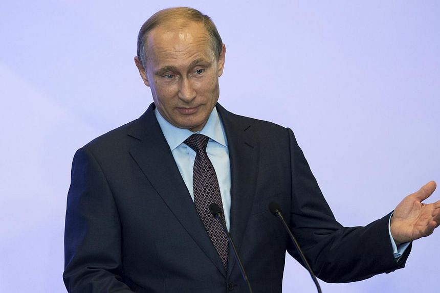 Russian President Vladimir Putin delivers a speech during a meeting with deputies of the Russian Parliament and other politicians and officials at Sanatorium Mriya near Yalta, Crimea on Thursday, Aug 14, 2014.President Vladimir Putin said on Th