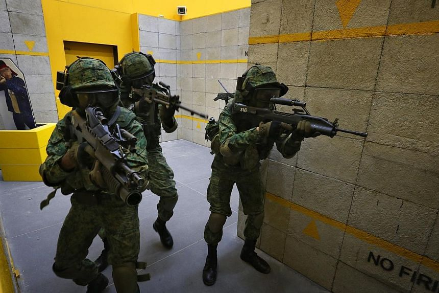 The foot soldiers of the Singapore Armed Forces (SAF) will get 50 to 60 per cent more hands-on experience with firing live rounds during combat training, as the SAF increasingly equips soldiers with the skills to fight in the urban zone. -- ST PHOTO: