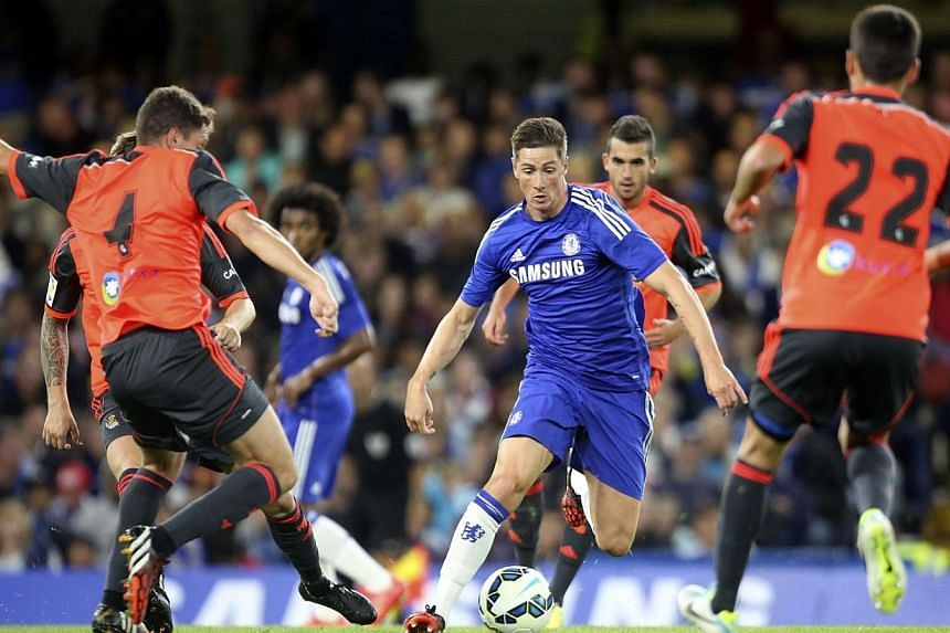 Chelsea's Fernando Torres (centre) is surrounded by Real Sociedad players during their friendly soccer match at Stamford Bridge in London on Aug 12, 2014. Torres' dramatic loss of form since his high-profile transfer from Liverpool to Chelsea in 2011