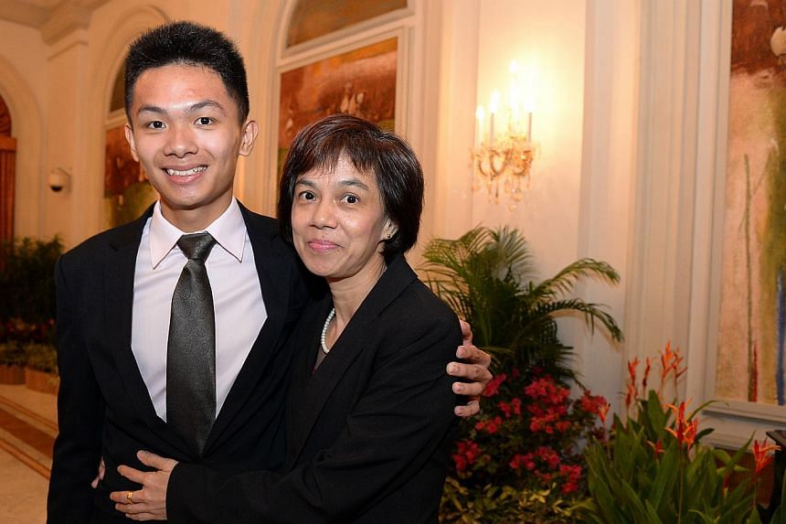 Mr Arturo Neo with his mother, Madam Ng Mui Soo, who raised three children on a single income as a childcare teacher.