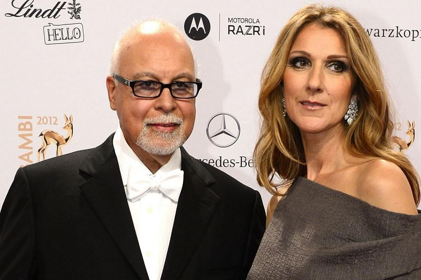 This Nov 22, 2012 file photo shows Canadian singer Celine Dion (right) and her husband Rene Angelil arriving for the Bambi Awards in Duesseldorf, western Germany. Celine Dion has indefinitely halted all her show business activity and cancelled h