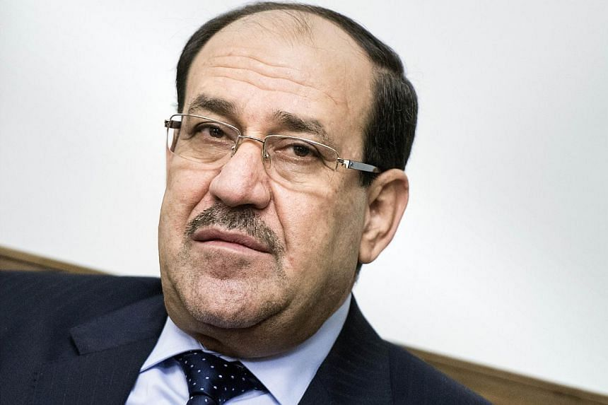 A file picture taken on June 23, 2014 shows Iraqi Prime Minister Nouri al-Maliki looking on during a meeting with the US Secretary of State at the Prime Minister's Office in Baghdad. Mr Malikihas refused to stand aside to allow his replacement