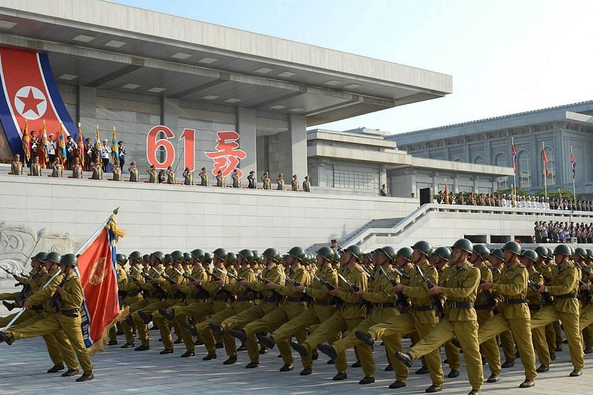 Military personnel march during an event at the plaza of the Kumsusan Palace of the Sun marking the 61st anniversary of the armistice that ended the Korean War taken on July 27, 2014 in this photo released by North Korea's Korean Central News Agency