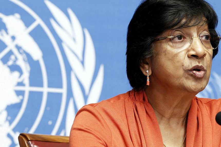"UN High Commissioner for Human Rights Navi Pillay speaks during a news conference for a report on ""the right to privacy in the digital age"" at the United Nations in Geneva on July 16, 2014. Sri Lanka accused the United Nations' human rights chie"