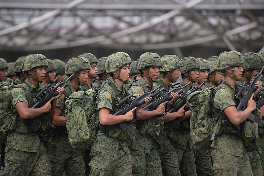 """The Singapore Armed Forces will take in its first volunteer corps next March but will not be aiming for """"mass numbers"""", Defence Minister Ng Eng Hen said on Thursday, Aug 14, 2014. -- ST PHOTO:MARK CHEONG"""