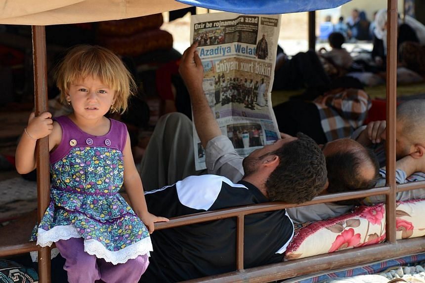 Displaced Iraqi people from the Yazidi community are pictured in a refugee camp near the Turkey-Iraq border at Silopi in Sirnak on Aug 14, 2014.Turkey is providing refuge to some 2,000 members of Iraq's Yazidi community who have fled the deadly