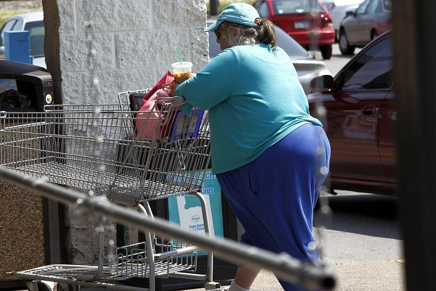 An overweight Huntington resident heads into a local supermarket for groceries. -- PHOTO: ST FILE