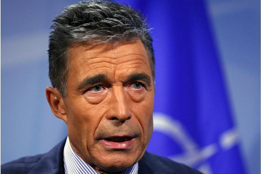 Nato Secretary-General Anders Fogh Rasmussen speaks during an interview with Reuters at the Alliance headquarters in Brussels August 11, 2014. In Iceland on Wednesday, he said Russia hoped to establish a sphere of Russian influence in surroundin