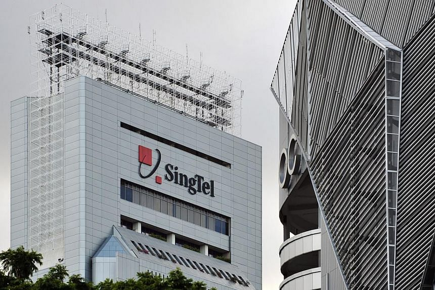 The SingTel building in Somerset Road. Telco SingTel garnered more than home 100,000 subscribers for its recent World Cup screening, but saw a 17 per cent drop in net profit in the first quarter from a year earlier. -- PHOTO: ST FILE
