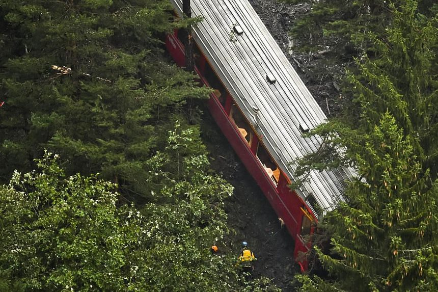 View of a train after it was derailed by a landslide near Tiefencastel, in a mountainous part of eastern Switzerland, on Aug 13, 1014. -- PHOTO: AFP