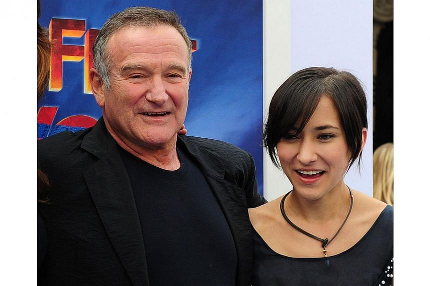 In this November 13, 2011 file photo, US actor and comedian Robin Williams and his daughter Zelda pose on arrival for the world premiere of the movie Happy Feet Two in Hollywood, California. According to media outlets on August 13, 2014 Zelda William