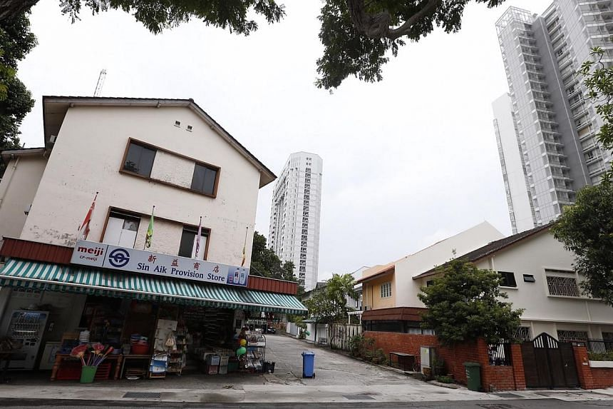 The walk-up apartment with a provision shop along Tanjong Katong Road (left) that will make way for Amber Station as seenon Aug 15, 2014. -- ST PHOTO: KEVIN LIM