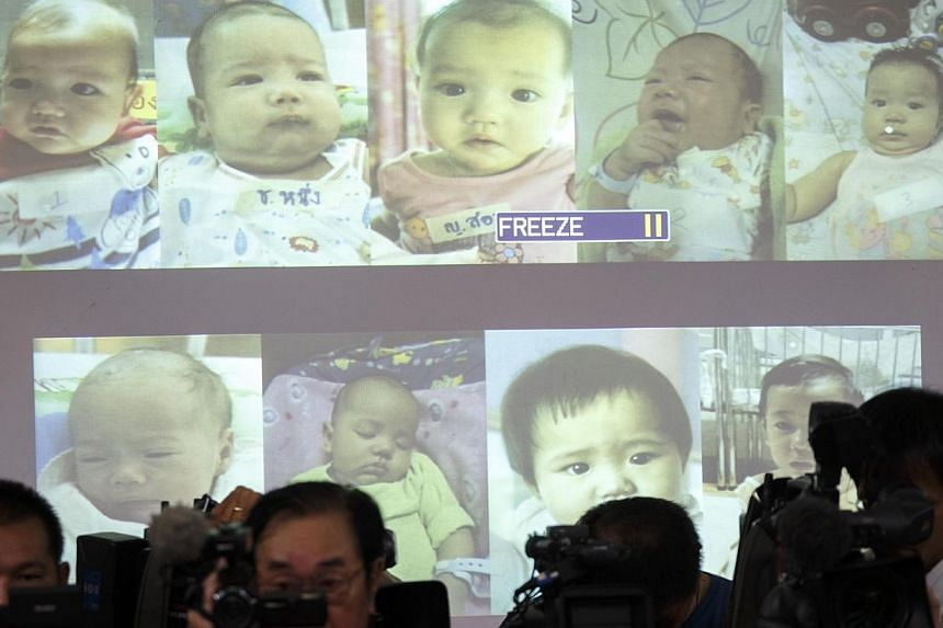 Surrogate babies that Thai police suspect were fathered by a Japanese businessman who has fled from Thailand are shown on a screen during a news conference at the headquarters of the Royal Thai Police in Bangkok on Aug 12, 2014. Authorities have foun