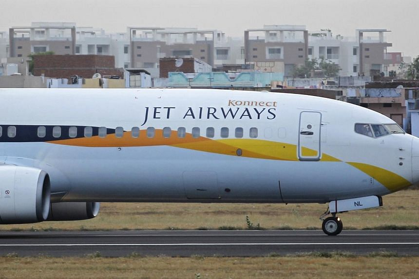 A Jet Airways passenger plane moves along the tarmac at the Sardar Vallabhbhai Patel international airport in the western Indian city of Ahmedabad.-- PHOTO: REUTERS