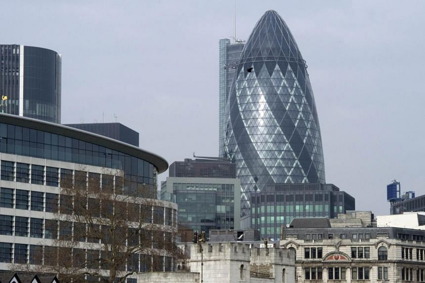 The City of London, London's main financial district. Britain's economy grew by 0.8 per cent in the second quarter of 2014 compared with output in the first three months of the year, official data showed on Friday. -- PHOTO: AFP