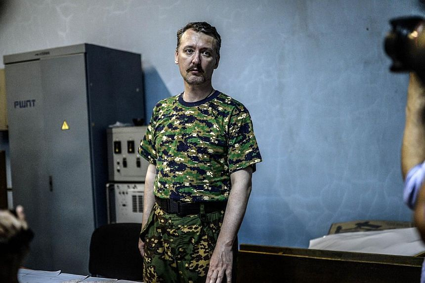 """A file picture dated July 28, 2014 shows Igor Strelkov, the top military commander of the self-proclaimed """"Donetsk People's Republic"""", delivering a press conference in Donetsk, eastern Ukraine. The main military commander of pro-Russian rebels battli"""