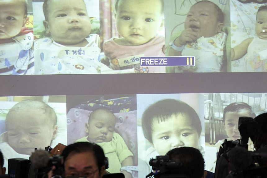 Surrogate babies that Thai police suspect were fathered by a Japanese businessman who has fled from Thailand are shown on a screen during a news conference at the headquarters of the Royal Thai Police in Bangkok August 12, 2014. The day after t