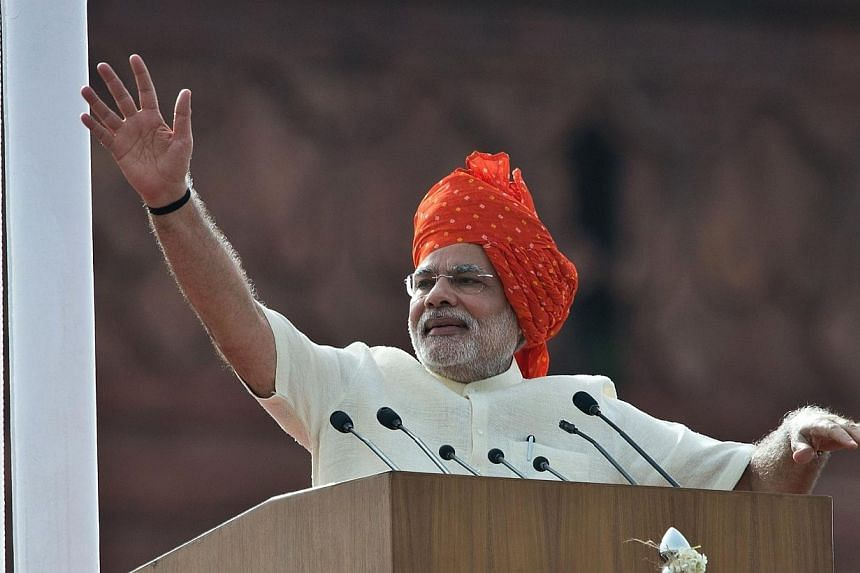 India's Prime Minister Narendra Modi waves at the end of his speech from the Red Fort to mark the country's 68th Independence Day in New Delhi on Aug 15, 2014. Modi voiced dismay on Friday at the government in-fighting he found on assuming offic