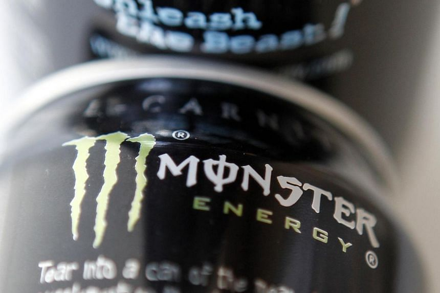 Two cans of Monster energy drink are shown in this file photo illustration in Los Angeles on Oct 23, 2012. Coca-Cola announced Thursday it will pay US$2.15 billion (S$2.68 billion) for a 16.7 per cent stake in Monster Beverage, cementing a distr