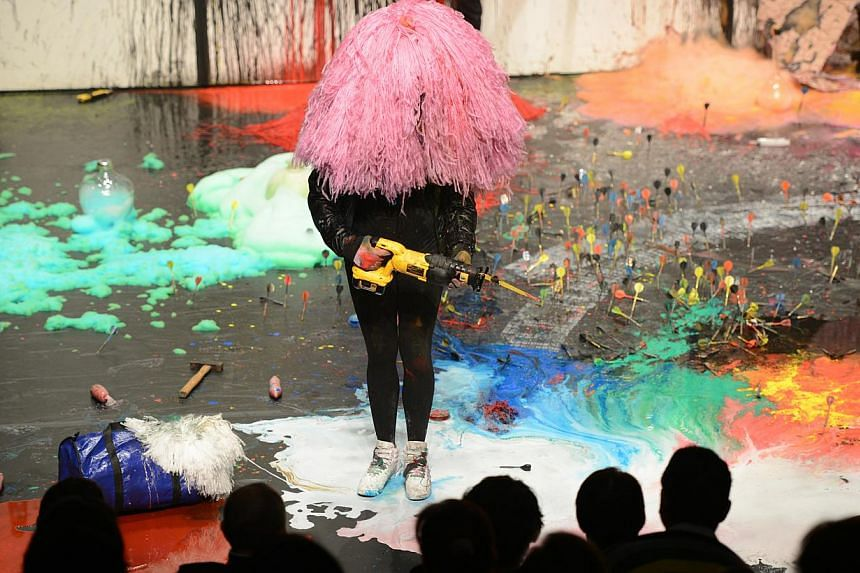 The performance Mystery Magnet, conceived by Belgian artist Miet Warlop, is a largely wordless show that speaks through a riot of colours and evocative scenes. -- PHOTO: CHONG YEW, SINGAPORE INTERNATIONAL FESTIVAL OF ARTS