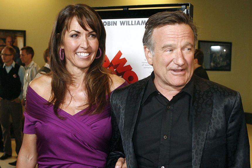 Actor Robin Williams, star of the film World's Greatest Dad, escorts wife Susan Schneider at the film's premiere in Los Angeles, California in this file picture taken on August 13, 2009. His wife on Thursday said Williams had been suffering from depr