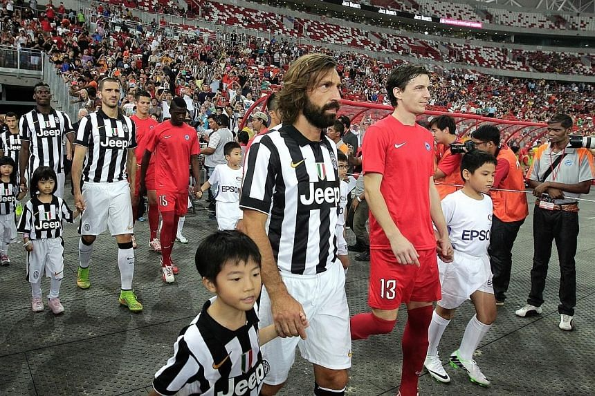 Juventus playmaker Andrea Pirlo (centre) was the toast of the night. -- ST PHOTO: NEO XIAOBIN
