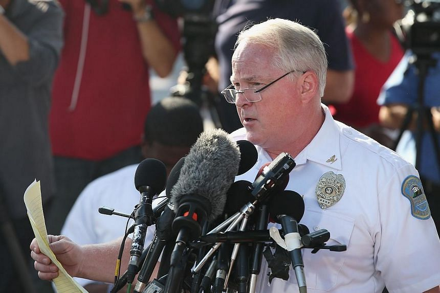 Ferguson Police Chief Thomas Jackson announces the name of the Ferguson police officer responsible for the August 9, shooting death of teenager Michael Brown on Aug 15, 2014 in Ferguson, Missouri. -- PHOTO: AFP