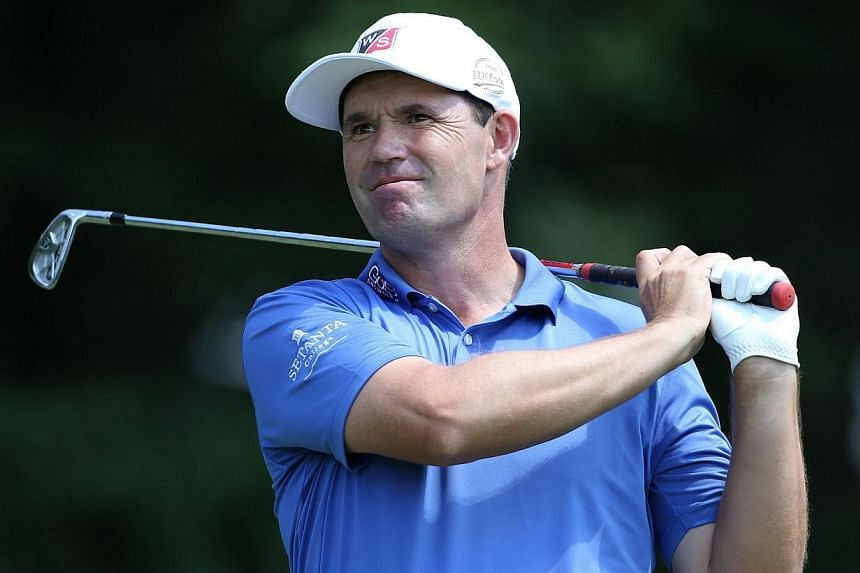 Padraig Harrington of Ireland plays his tee shot on the seventh hole during the first round of the Wyndham Championship at Sedgefield Country Club on Aug 14, 2014 in Greensboro, North Carolina. -- PHOTO: AFP