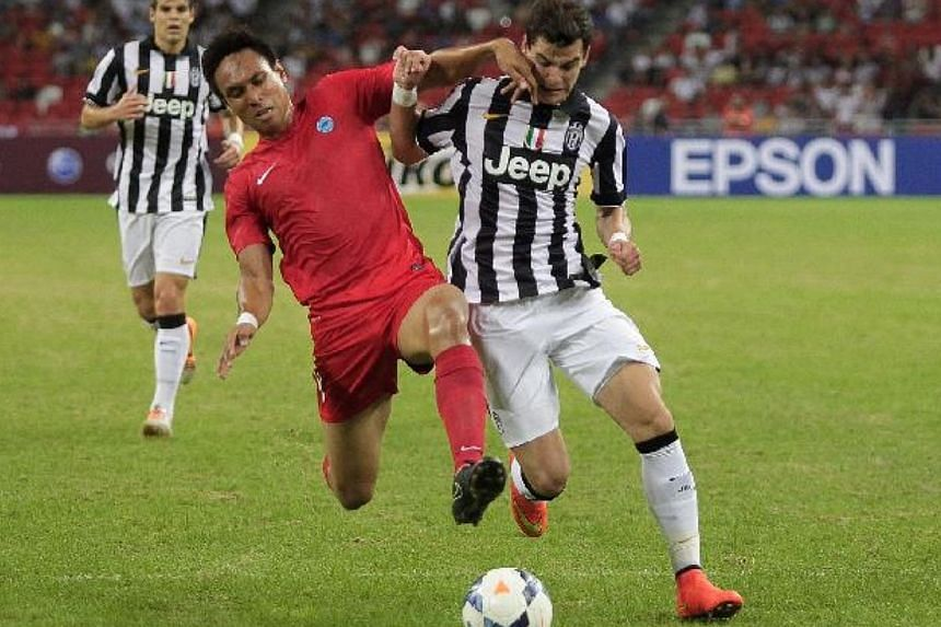 Italian Serie A champions Juventus beat a Singapore Selection side 5-0 in a friendly match at the new National Stadium on Saturday night. -- ST PHOTO: NEO XIAOBIN