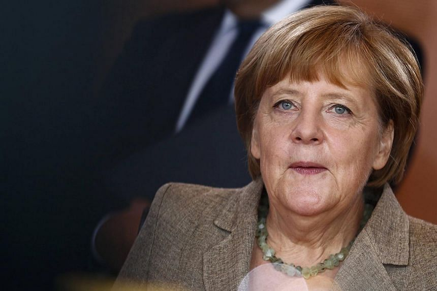 """German Chancellor Angela Merkel attends a cabinet meeting at the Chancellery in Berlin on Aug 13, 2014.Dr Merkel urged Russian President Vladimir Putin to """"stop the flow of military equipment, military advisers and armed personnel crossing the"""