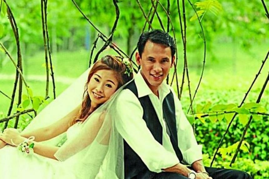 Elaine Chew and her husband Tan Size Hiang, a crew member of Malaysia Airlines Flight MH370. -- PHOTO: THE STAR / ASIA NEWS NETWORK