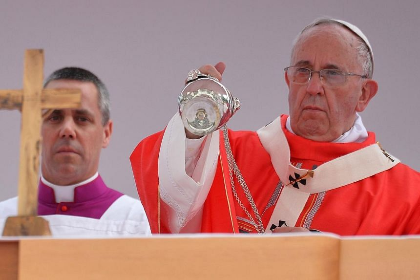 Pope Francis (right) takes part in a beatification mass at Gwanghwamun Square in central Seoul on Aug 16, 2014. -- PHOTO: AFP