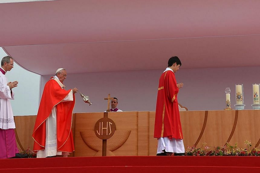 Pope Francis (2nd left) takes part in a beatification mass at Gwanghwamun Square in central Seoul on Aug 16, 2014. -- PHOTO: AFP