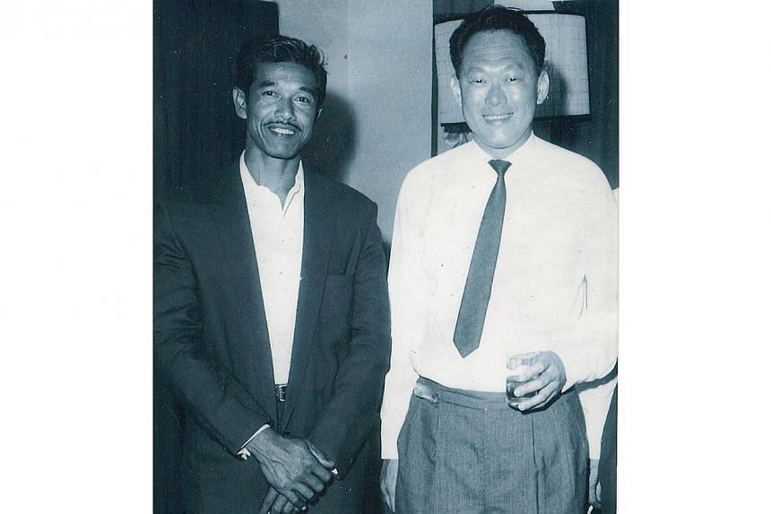 Mr Rahmat Yusak (left) with former prime minister Lee Kuan Yew. Mr Rahmat was Mr Lee's driver when the latter was visiting constituencies around the island in the battle against the communists. -- PHOTO:COURTESY OF ZULKIFLI RAHMAT