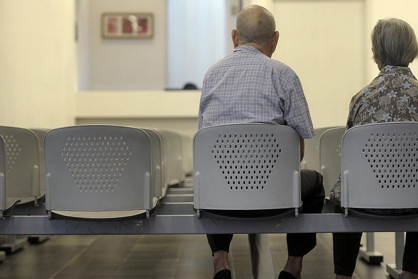 An elderly couple at the Choa Chu Kang Polyclinic. Prime Minister Lee Hsien Loong in his National Day Rally speech said more must be done to help about 10 to 20 per cent of elderly Singaporeans who do not have enough savings in their Central Pro