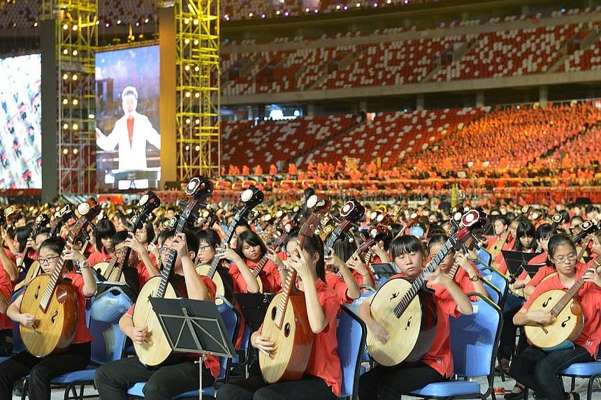 """Members of the Singapore Chinese Orchestra (SCO) performing at Singapore Sports Hub on 28 June 2014. The republic has developed its own """"Nanyang"""" style of Chinese culture and a new centre will promote it, Prime Minister Lee Hsien Loong said in his sp"""