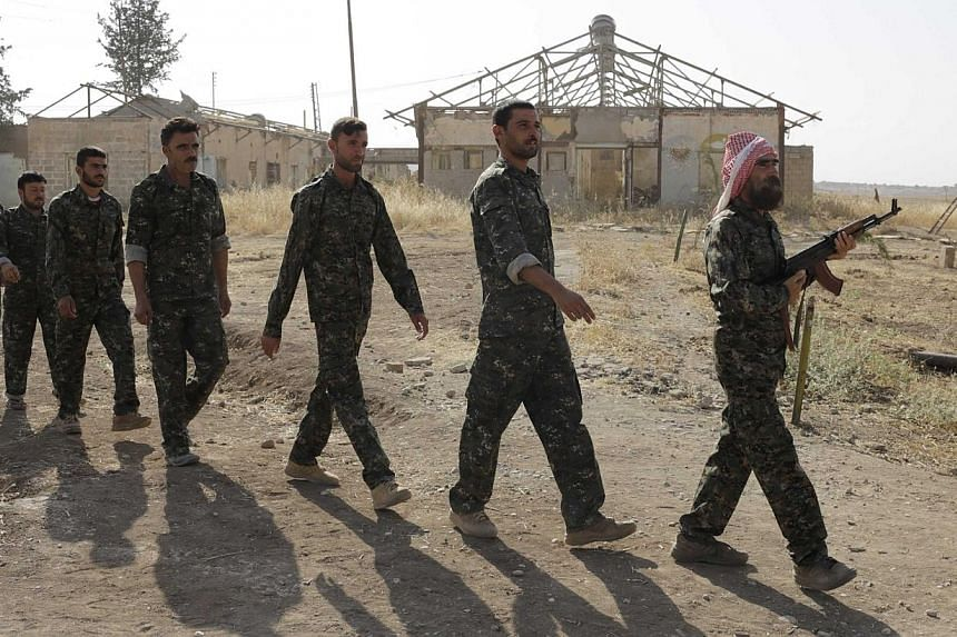 Iraqi volunteers from the Yazidi sect participate in a training camp at the Serimli military base, which is controlled by the Kurdish People's Protection Units (YPG), in Qamishli, northeastern Syria on the border with Kurdistan on Aug 16, 2014.